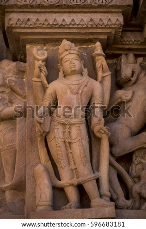 Khajuraho / India 24 February 2017 Sculptures of lord vishnu at Lakshmana Temple is a Hindu temple  in madhya pradesh India #596683181