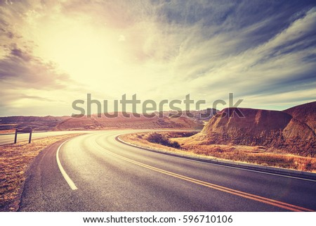 Vintage toned scenic desert highway at sunset, travel concept, USA.