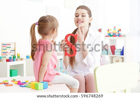Cute little girl at speech therapist office #596748269
