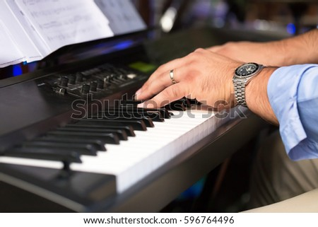 man hand play in piano keyboard #596764496