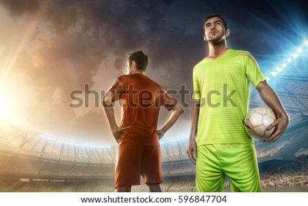 Soccer players on a soccer field #596847704