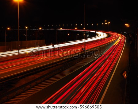 The Vilvoorde viaduct part of the Brussels ring road photographed at night with a slow shutter speed.