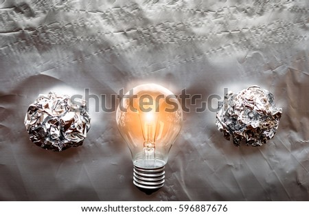 concept of idea illustration lit lamp on silver background #596887676