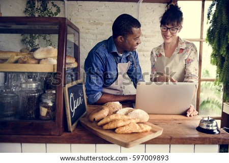 Couple partnership the bakehouse with e-busness online Royalty-Free Stock Photo #597009893