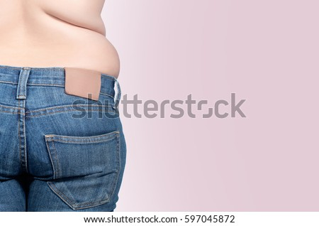 back view. asian fat women has overweight. she shows excess fat of the waist. isolated on violet background. she wants lose weight. concept of surgery and subcutaneous fat breakdown. #597045872
