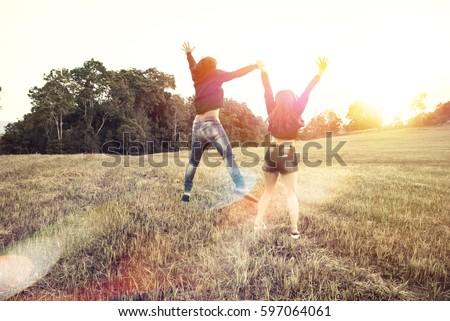 Lovers walk hand in hand on romantic evening sun, romantic atmosphere. #597064061