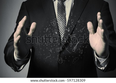 Businessman holding a cloud with dreams in his hand. Consumer credit. #597128309
