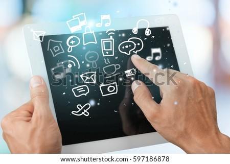 Hand using digital tablet. #597186878