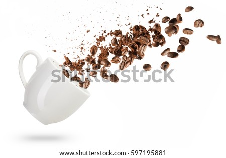 coffee beans spilled out of a cup isolated on white background #597195881