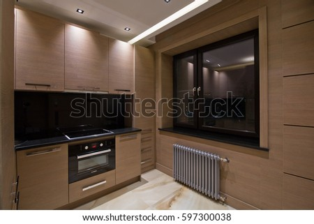 Kitchen in the styles of constructivism and neoclassicism, with brown wood paneling on the walls and marble flooring, stock photo #597300038