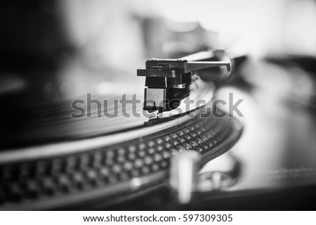 Turntable vinyl records player playing analog disc with music.Close up,focus on needle cartridge headshell.DJ audio equipment for scratch #597309305