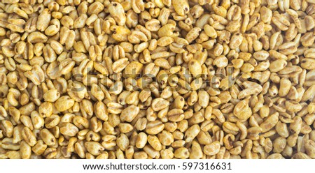 Heap of Puffed Wheat Snack Background. Healthy Cereal Vegetarian or Vegan Food #597316631
