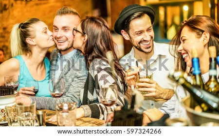 Fashion trendy friends drinking cocktails and wine in bar winery shop - Young students having party in night club - Fun with friends concept - Main focus on right man face Unfiltered photo with flash #597324266