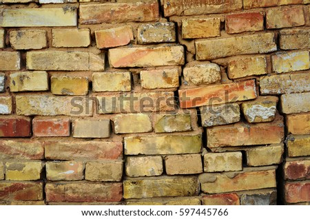 Brick wall background. Crack in brickwork #597445766