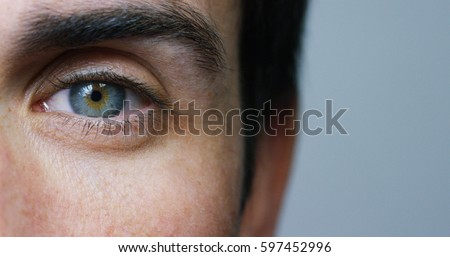 perfect blue eye macro in a sterile environment and perfect vision in resolution 6k,  concept, the vision of the future and healthy life concept. view precise and straight to the target. Royalty-Free Stock Photo #597452996