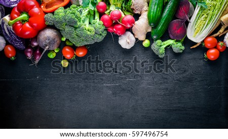 Big set organic food. Fresh raw vegetables. On a black chalkboard. #597496754