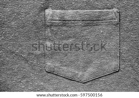 Breast pocket on the shirt - an element of clothing. Fabric for clothing background. Grey cloth as blank backdrop #597500156