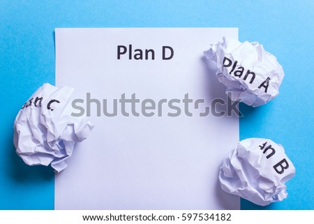 Crumpled paper Plan A B C and clean sheet Plan D on a blue background #597534182