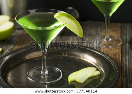 Homemade Green Alcoholic Appletini Cocktail with Apple Garnish #597548114