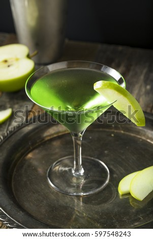 Homemade Green Alcoholic Appletini Cocktail with Apple Garnish #597548243