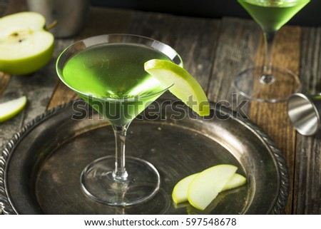 Homemade Green Alcoholic Appletini Cocktail with Apple Garnish #597548678