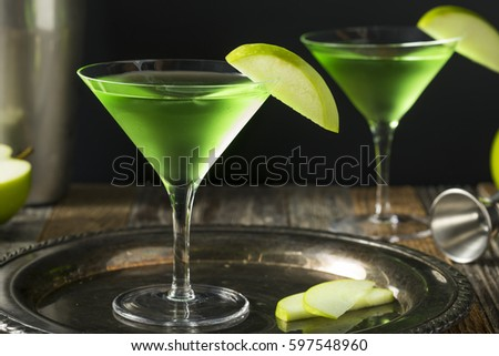 Homemade Green Alcoholic Appletini Cocktail with Apple Garnish #597548960