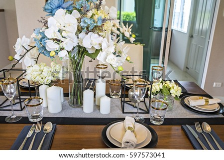 table set on wood dinning table at home Modern dinning room  #597573041