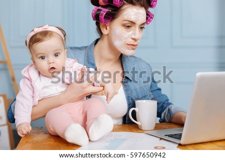 Dedicated adorable mother starting an active day #597650942