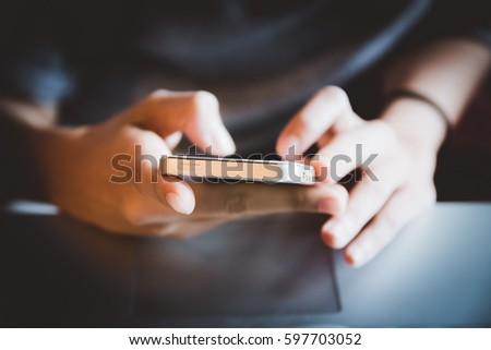 Hands holding a smart phone. Smart phone addiction concept. Technology and business concept. #597703052