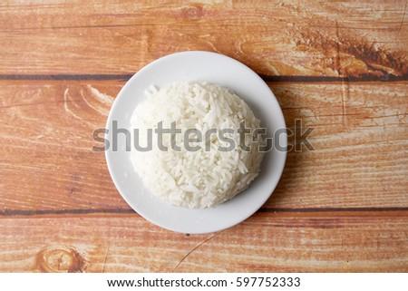 Plain steam rice on wooden background. #597752333