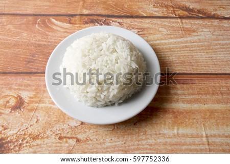 Plain steam rice on wooden background. #597752336