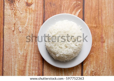 Plain steam rice on wooden background. #597752363