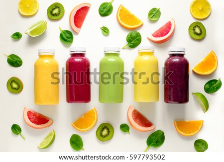 Various kind of smoothies or juices in bottles, healthy diet food concept, view from above #597793502