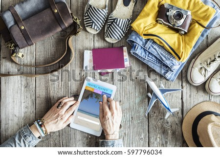 Travel concept on wooden table #597796034