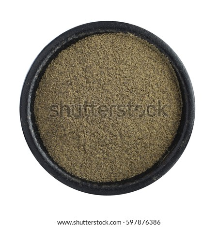 Heap of Ground Black Pepper in Iron Bowl Isolated Top View #597876386