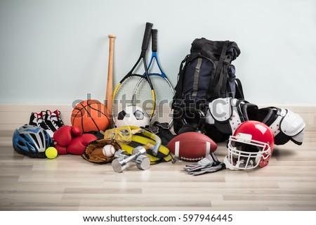 Photo Of Various Sport Equipments On Hardwood Floor Royalty-Free Stock Photo #597946445