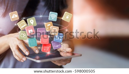 woman using mobile tablet payments online shopping and icon customer network connection on screen, pay all, m-banking and omni channel  Royalty-Free Stock Photo #598000505