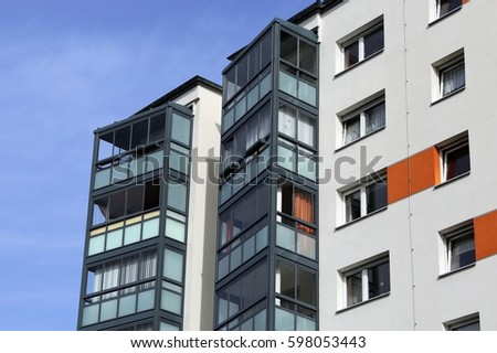 Apartment building with glazed balconies #598053443