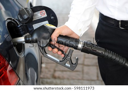 the cost of fuel increases - euro and gasoline - gas station - Diesel #598111973