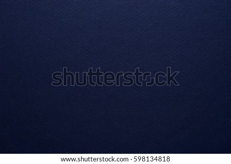 Paper texture background. High quality Grain texture in a high resolution. Dark blue color. Fine arts paper.