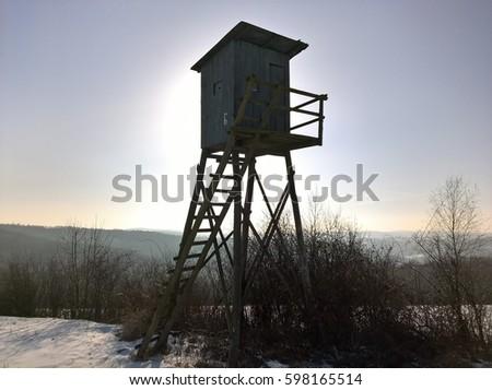 Deer Blind High. Hunter's observation point in forest (winter). #598165514