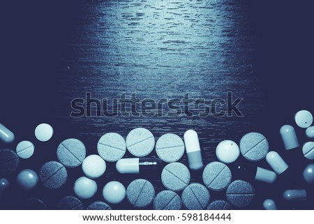 Drug prescription for treatment medication. Pharmaceutical medicament, cure in container for health. Pharmacy theme, capsule pills with medicine antibiotic in packages. #598184444