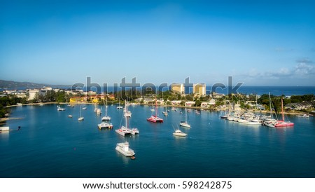 Panoramic view of Montego Bay, Jamaica on a stunning spring day featuring boats floating in the emerald waters of the bay #598242875