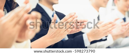 Group of business people clapping their hands at the meeting, panoramic banner #598273790