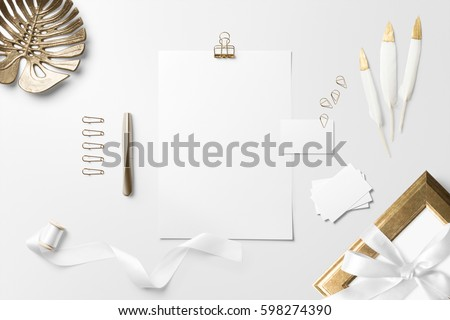 Letterhead, business card scene mockup, top view, with decor elements, feathers and blank copy, logo space on white background.