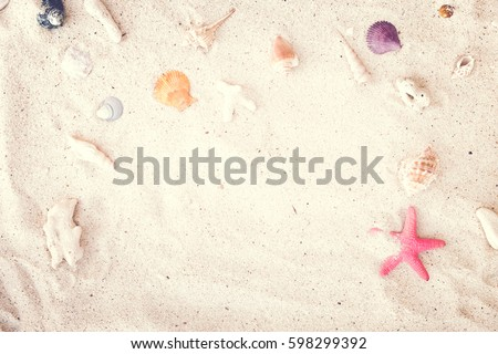 Top view of Beach sand with shells and starfish. summer background concept. vintage tone.