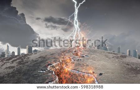 Idea of catastrophe and danger . Mixed media Royalty-Free Stock Photo #598318988