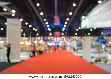 Abstract blur people in exhibition hall event background Royalty-Free Stock Photo #598342223
