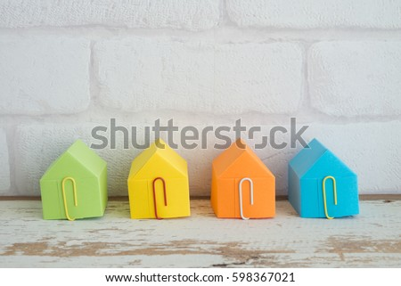 Colorful paper house on wooden table background with free copy space - ideas house real estate concept #598367021