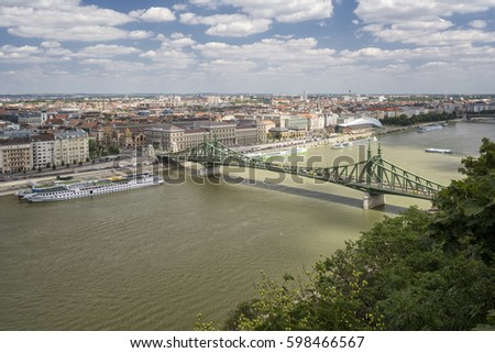 BUDAPEST, HUNGARY, JULY 10, 2015: Panoramic view of Danube River and Elisabeth Bridge (Erzsebet Hid), the third newest bridge of Budapest, Hungary, connecting Buda and Pest across the River Danube. #598466567